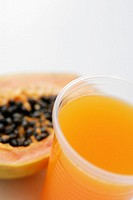 High angle view of a glass of juice with a papaya