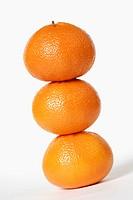 Close-up of a stack of three oranges