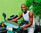 Portrait of a young man riding a scooter, Bermuda