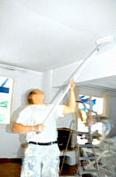 Man using ceiling paint roller