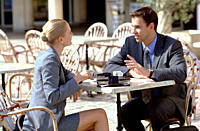 Businesswoman and businessman at outdoor cafe