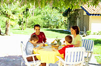 Family eating at outdoor table