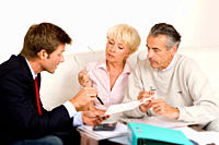 Businessman helping senior couple with finances