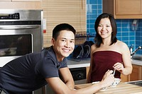 Portrait of a young couple smiling in the kitchen
