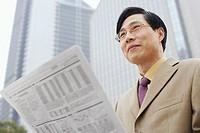 Close-up of a businessman with a newspaper