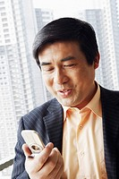 Close-up of a businessman looking at a mobile phone