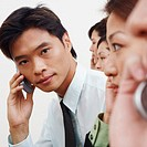 Portrait of a businessman talking on a mobile phone with his colleagues