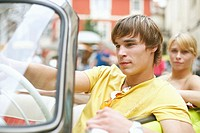 Close-up of a young man sitting in a car