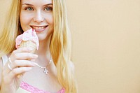 Portrait of a young woman holding an ice-cream cone