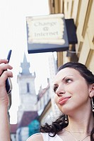 Low angle view of a young woman looking at a mobile phone