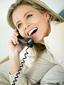 Close-up of a mid adult woman talking on the telephone