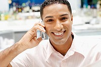 Portrait of a young man talking on a mobile phone
