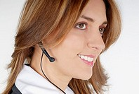 Side profile of a businesswoman with a hands free device (thumbnail)