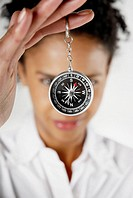 Close-up of a businesswoman holding a compass