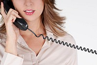 Mid section view of a businesswoman talking on the telephone