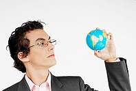 Close-up of a businessman holding a globe