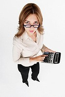 High angle view of a businesswoman using a calculator