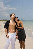 Close-up of a young couple standing on the beach