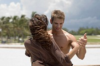 Close-up of a young couple dancing on the beach
