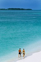 Rear view of a couple taking a stroll on a seashore, Paradise Island, Nassau, Bahamas