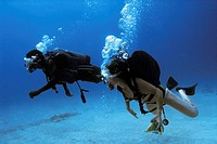 Scuba Divers are seen underwater in Jamaica