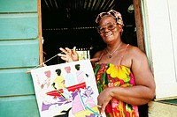 An African-American woman poses with a painting