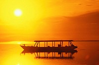 Silhouette of a boat moored in the sea, Bali, Indonesia (thumbnail)