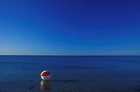 Beach ball in the sea, Cape Cod, Massachusetts, USA