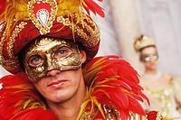 Portrait of a young man wearing a carnival mask, Venice, Veneto, Italy