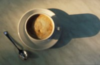 High angle view of a cup of coffee with a saucer and a spoon (thumbnail)