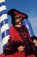 Low angle view of a young woman wearing a costume, Venice, Veneto, Italy