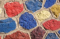 Close-up of a painted stone wall