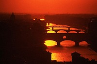 Silhouette of an arch bridge across a river, Ponte Vecchio, Arno River, Florence, Tuscany, Italy