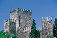 Flag on the top of a castle, Dukes of Braganca Palace, Guimaraes, Minho, Portugal