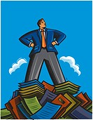 Businessman standing on top of a mountain of papers