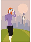 Woman with binoculars standing in front of Big Ben (thumbnail)