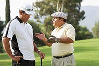 Two men having discussion on golf course