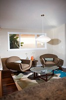 A stylish center table along with two armchairs are seen in the living room