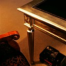 Side view of a section of armchair and a metallic table