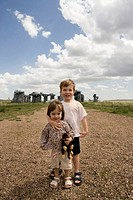 USA, Nebraska, Alliance, girl and boy (2-4) by Carhenge, portrait