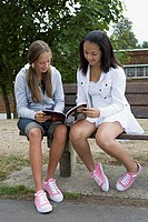 Girls reading a magazine