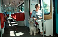 Woman, with, Mixed, Breed, Dog, in, tram, Germany
