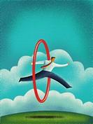 A business man jumping through a hula hoop