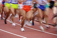 Blurred image of runners on track