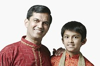 Portrait of a mature man and his son smiling