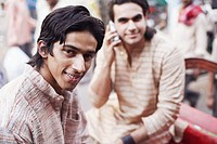 Portrait of two young men sitting in a rickshaw
