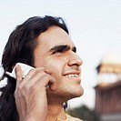 Close-up of a young man talking on a mobile phone