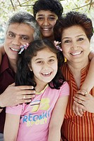 Portrait of grandparents and their two grandchildren smiling (thumbnail)