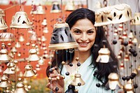 Portrait of a young woman choosing bells (thumbnail)