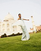 Side profile of a young woman standing in front of a mausoleum, Taj Mahal, Agra, Uttar Pradesh, India